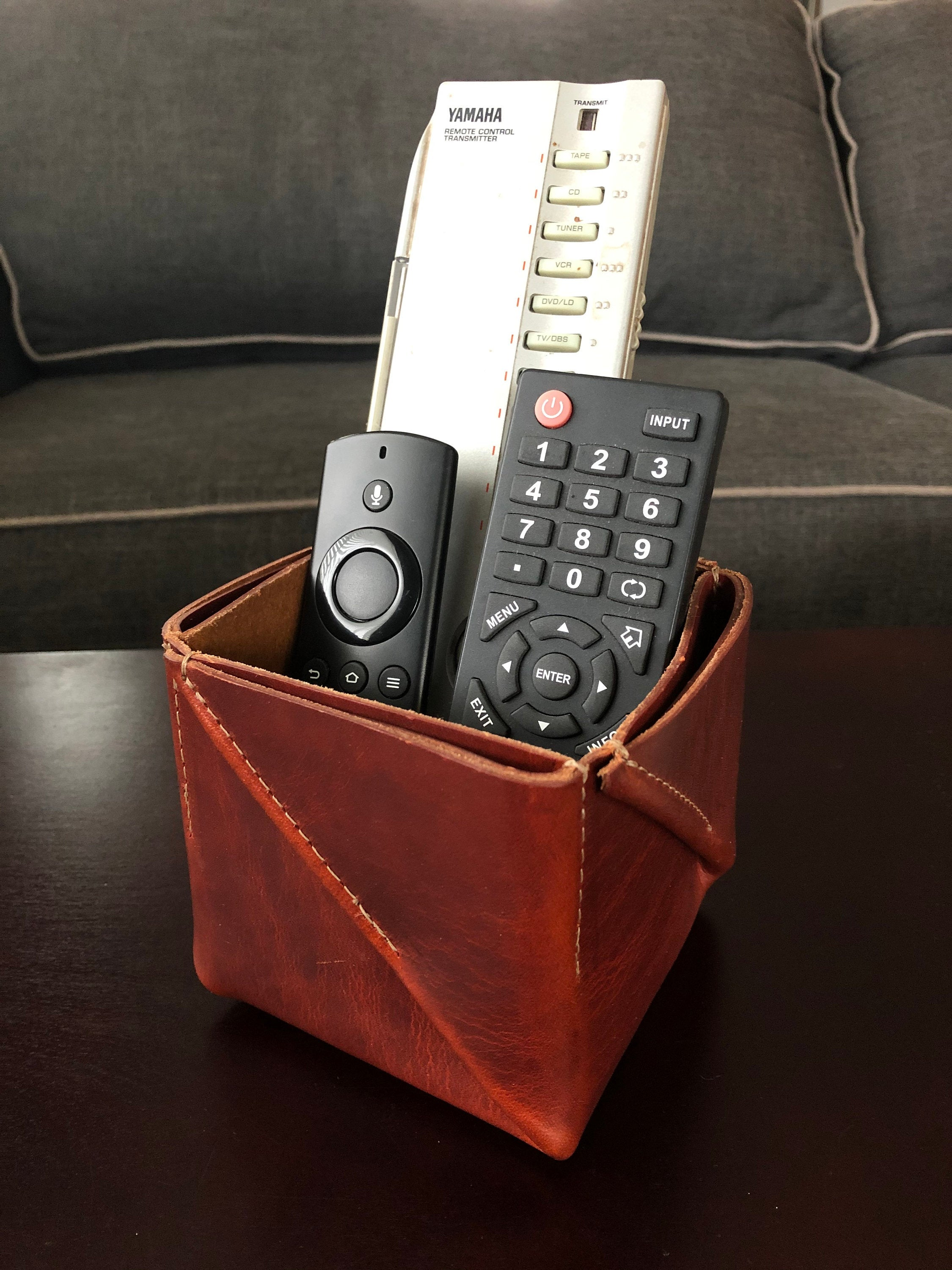 Folded leather box as remote control holder