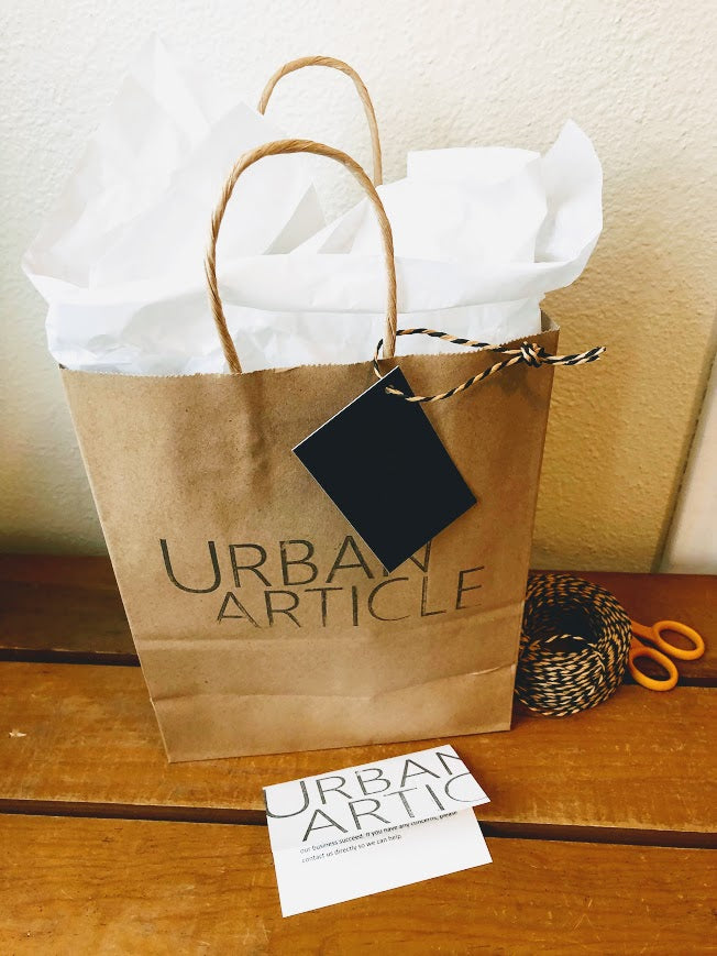Cute brown bag with Urban Article logo, white tissue, card and tag.