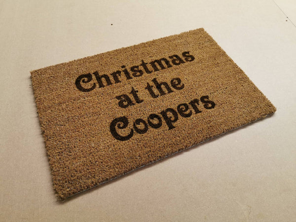 "Christmas at the ""surname"" door mat"