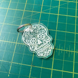 Candy skull / day of the dead key chain. Made from acrylic laser engraved and cut.