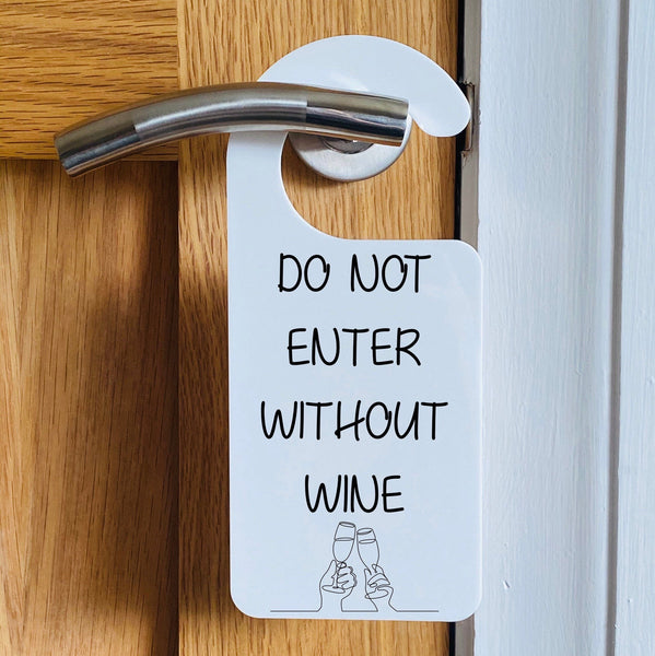 Do not enter without wine funny hanging door sign.
