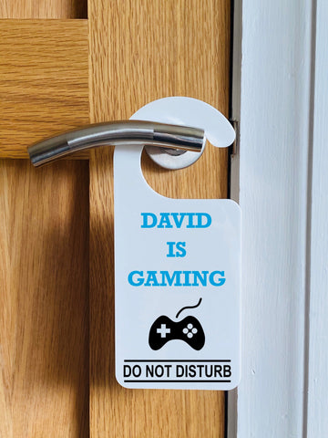 Do not disturb personalised name is gaming hanging door sign.