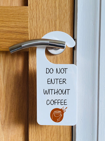 Do not enter without coffee, funny hanging door sign.