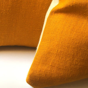 yellow cushion cover, neutral base details of corner