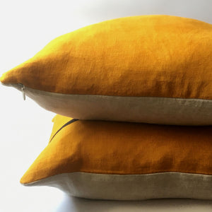 two yellow cushions stacked