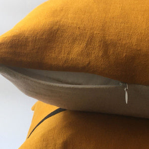 yellow cushion cover, neutral base with zip open