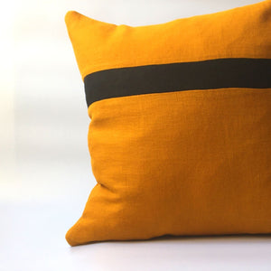 yellow cushion cover with black stripe running horizontally