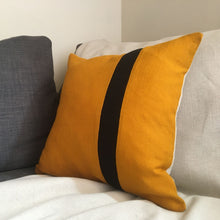 Load image into Gallery viewer, Bee cushion on grey sofa with black stripe