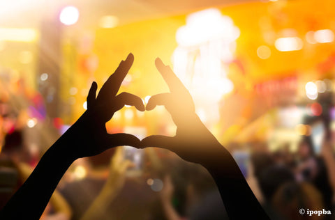 Love heart with hands at a festival
