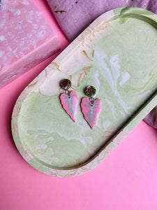 Pink botanical leaf earrings.
