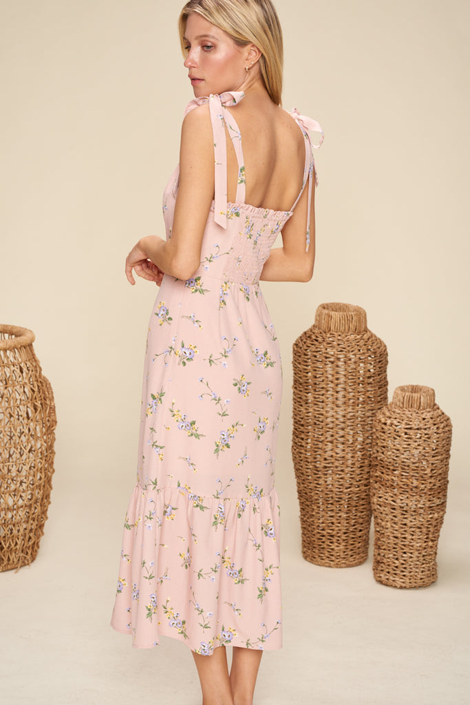Back side of a mauve sweetheart neckline floral midi dress with shoulder tie fastening.