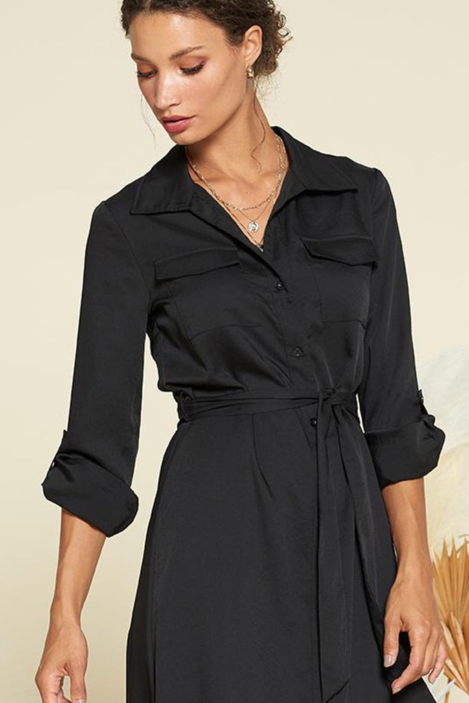A close up of black satin utility shirt midi dress with self waistband included.