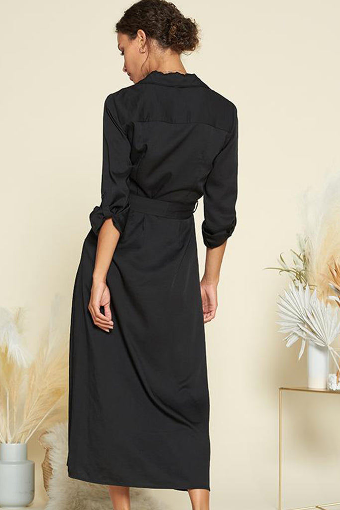 Back side of a black satin utility shirt midi dress with self waistband included.