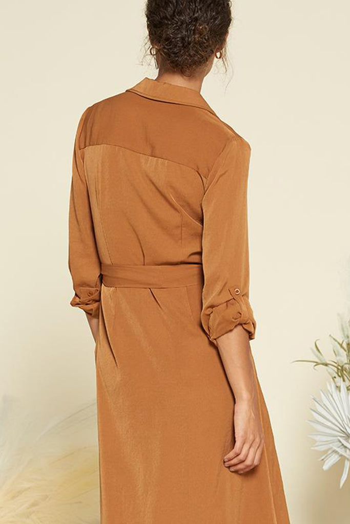 Back side of a brown satin utility shirt midi dress with self waistband included.