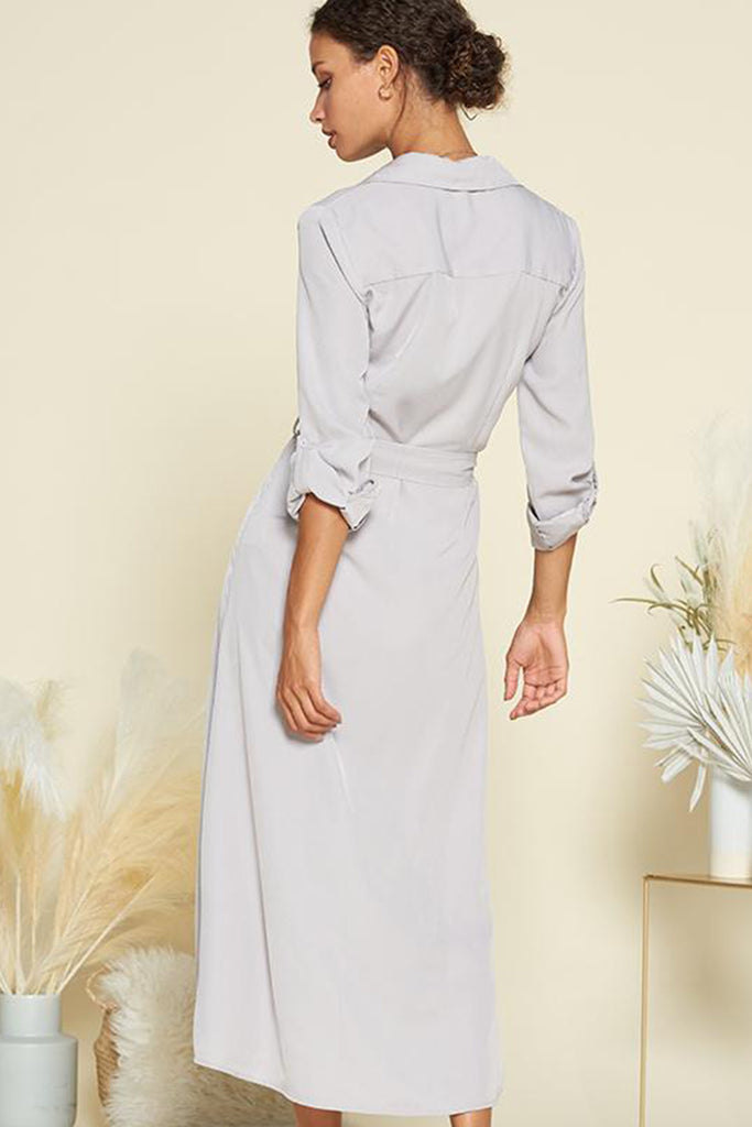 Back side of a slate grey satin utility shirt midi dress with self waistband included.