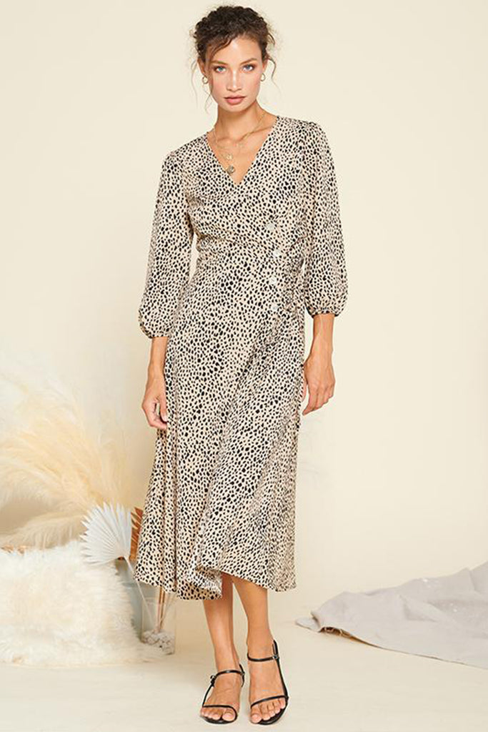 A woman wearing a taupe animal print shell button wrap closure midi dress.