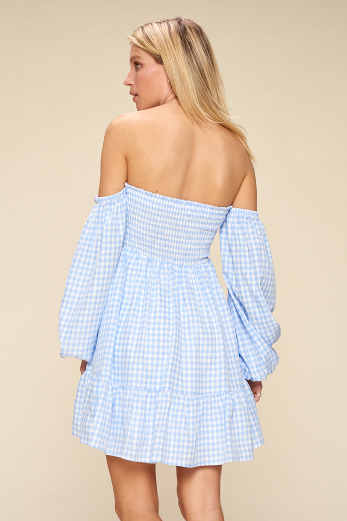Back side of a light blue gingham off shoulder mini dress.