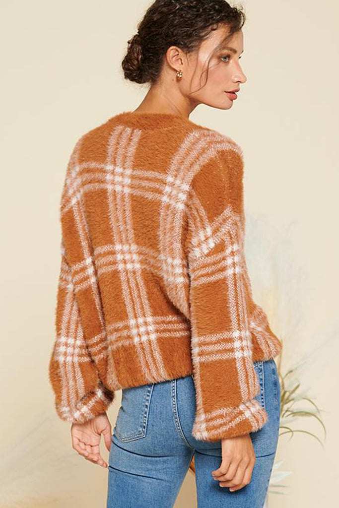 Back side of a rust fuzzy plaid cardigan.