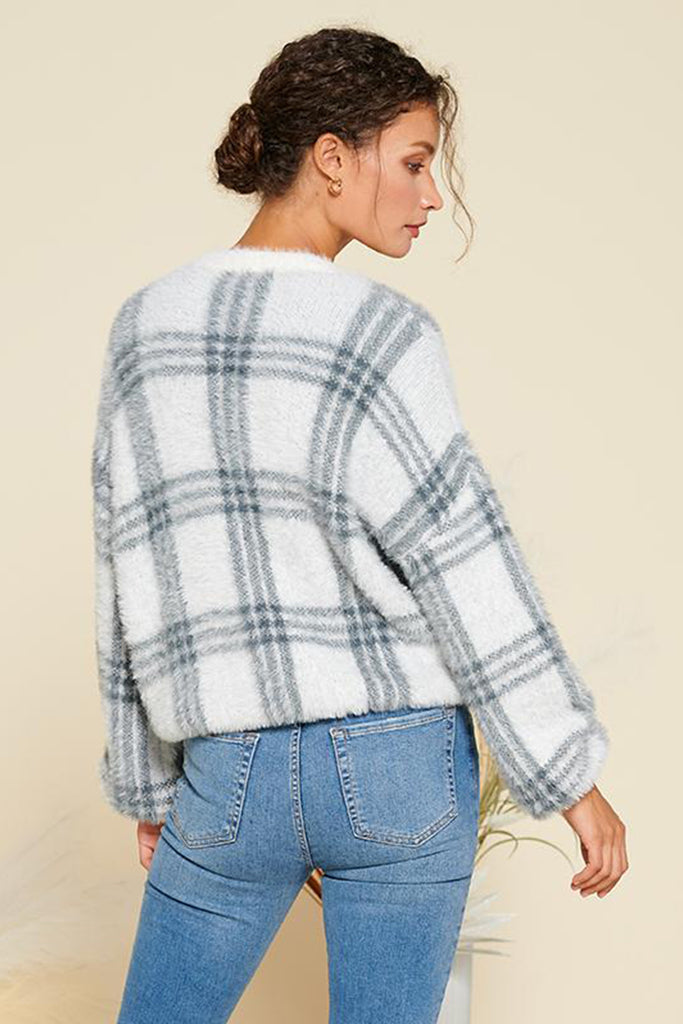 Back side of an ivory fuzzy plaid cardigan.
