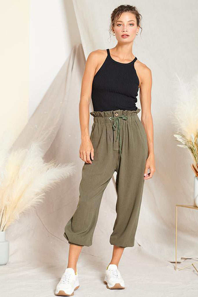 A woman wearing an olive paper bag joggers.