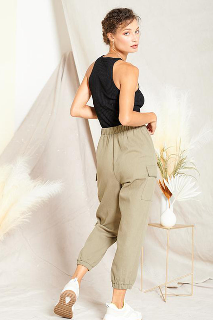 Back side of an olive cargo jogger pants.