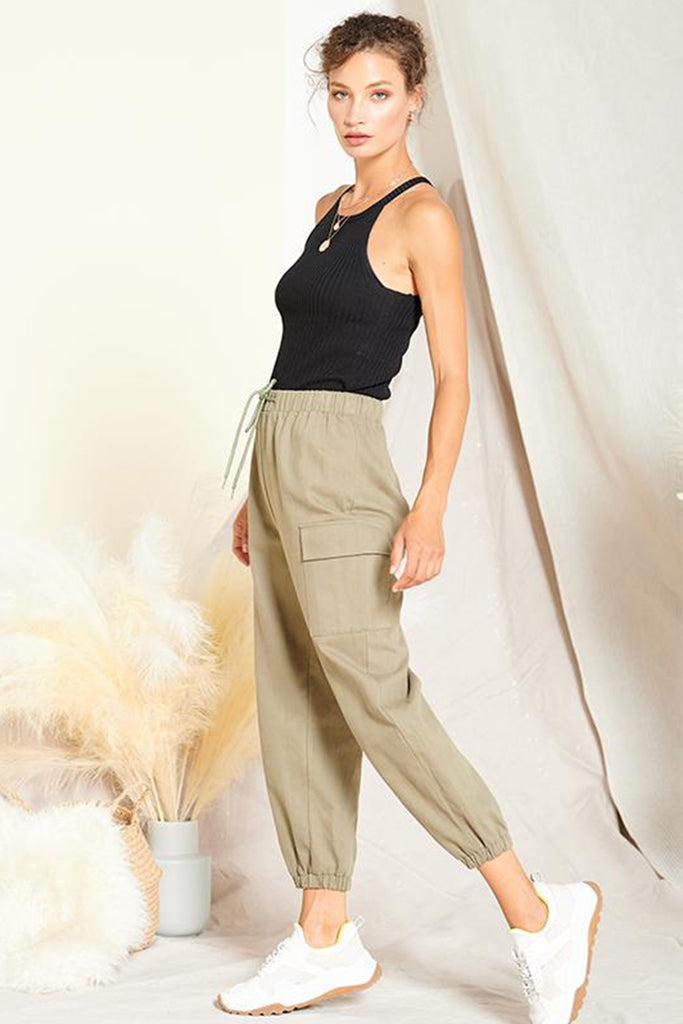 A woman wearing an olive cargo jogger pants.