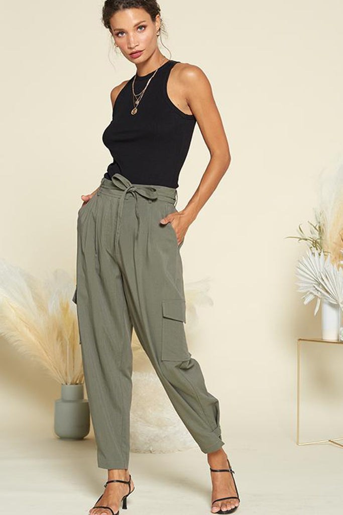 A woman wearing an olive utility jogger pants.