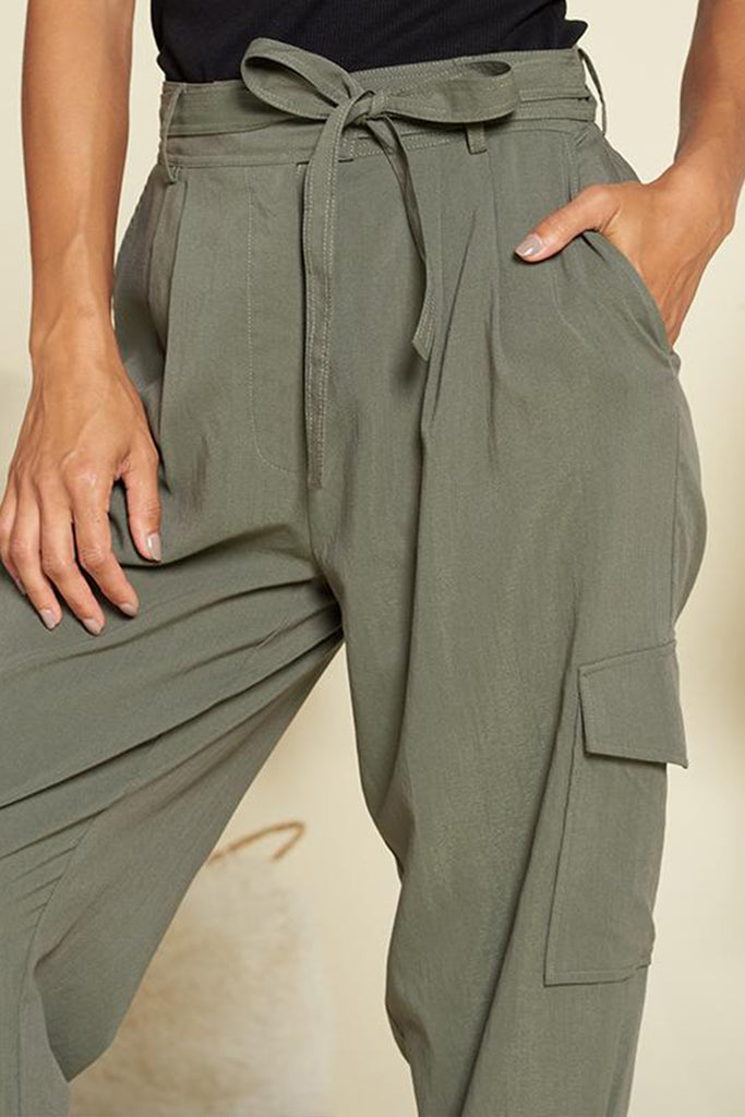 Close up of an olive utility jogger pants.