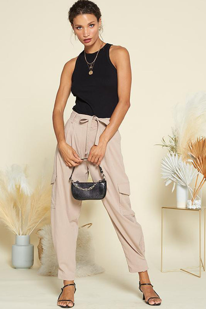 A woman wearing a taupe utility jogger pants.
