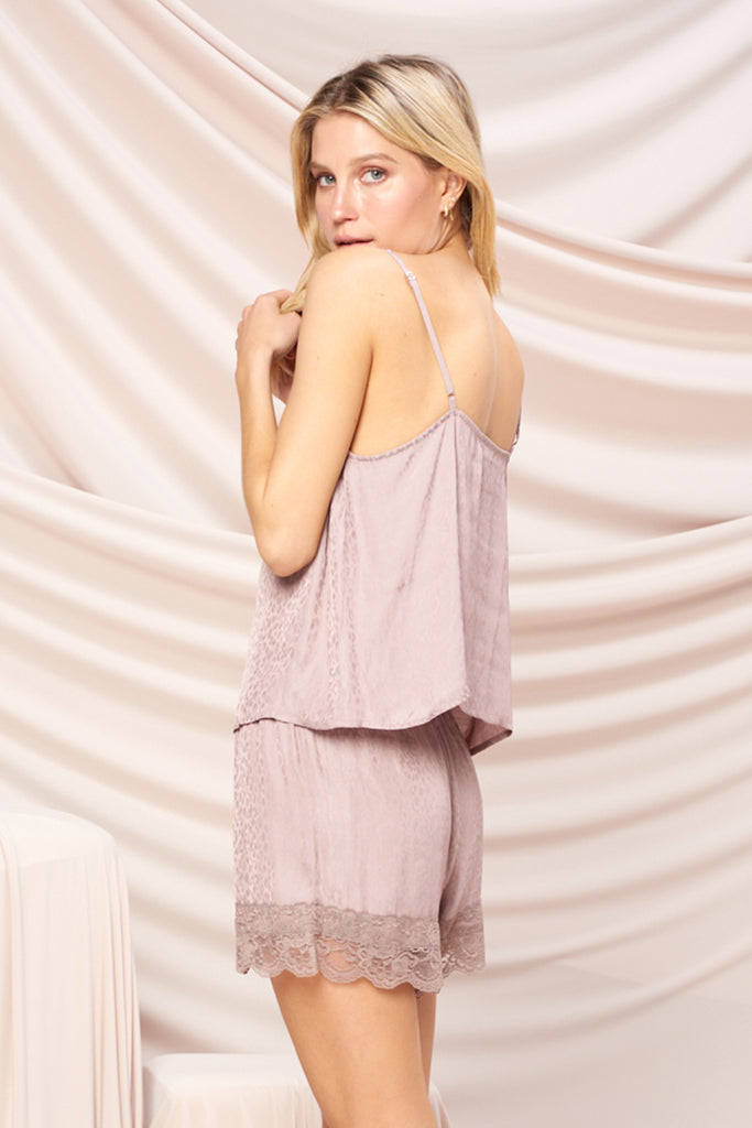 Back side of a mauve satin ditsy animal print PJ set with lace trim detail at neck and hem.