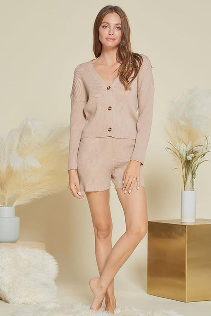 A woman wearing a taupe rib knitted sweater two piece set.