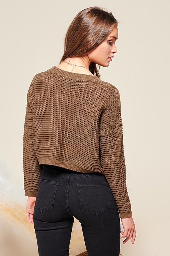 Back side of an olive cropped fishnet knitted sweater top.