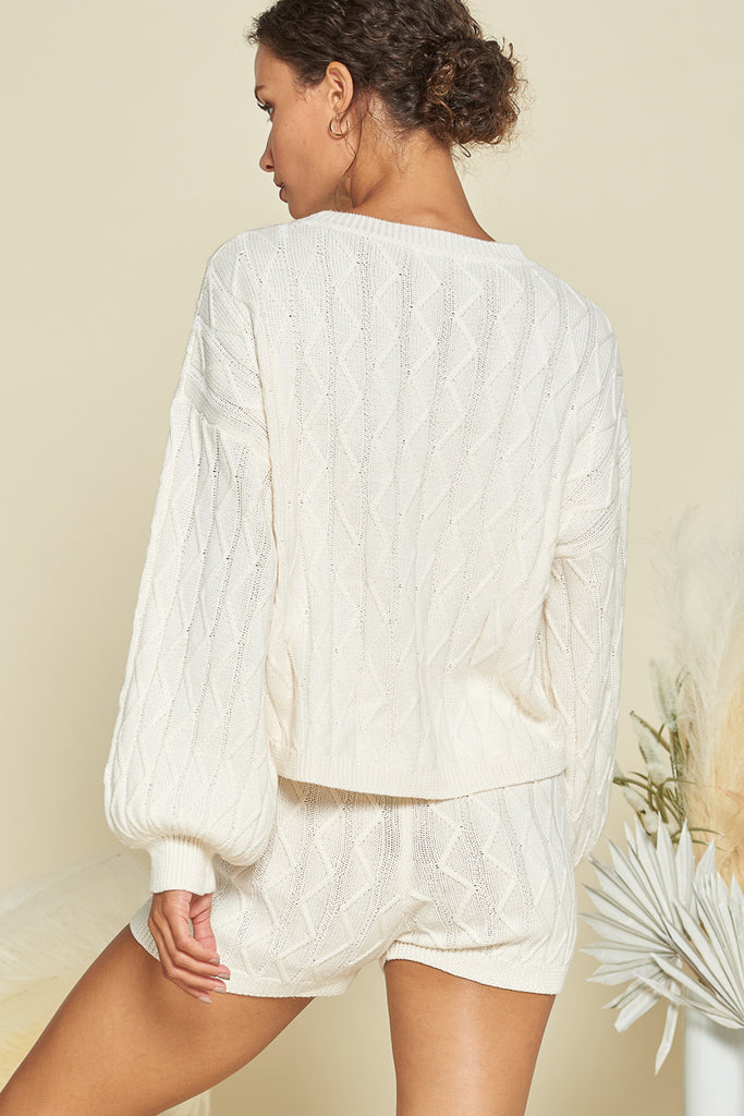 Back side of an ivory sweater loungewear two piece set.