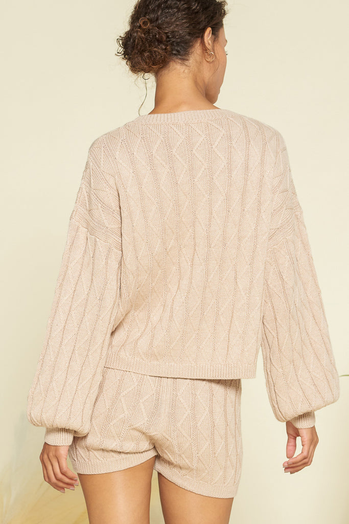 Back side of a taupe sweater loungewear two piece set.