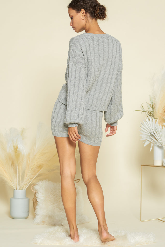 Back side of a heather grey sweater loungewear two piece set.
