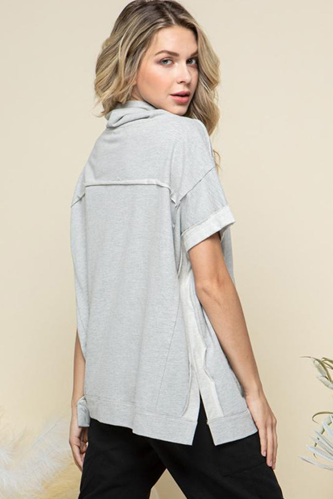 Back side of a heather grey cowl neck with adjustable drawstring lounge top.