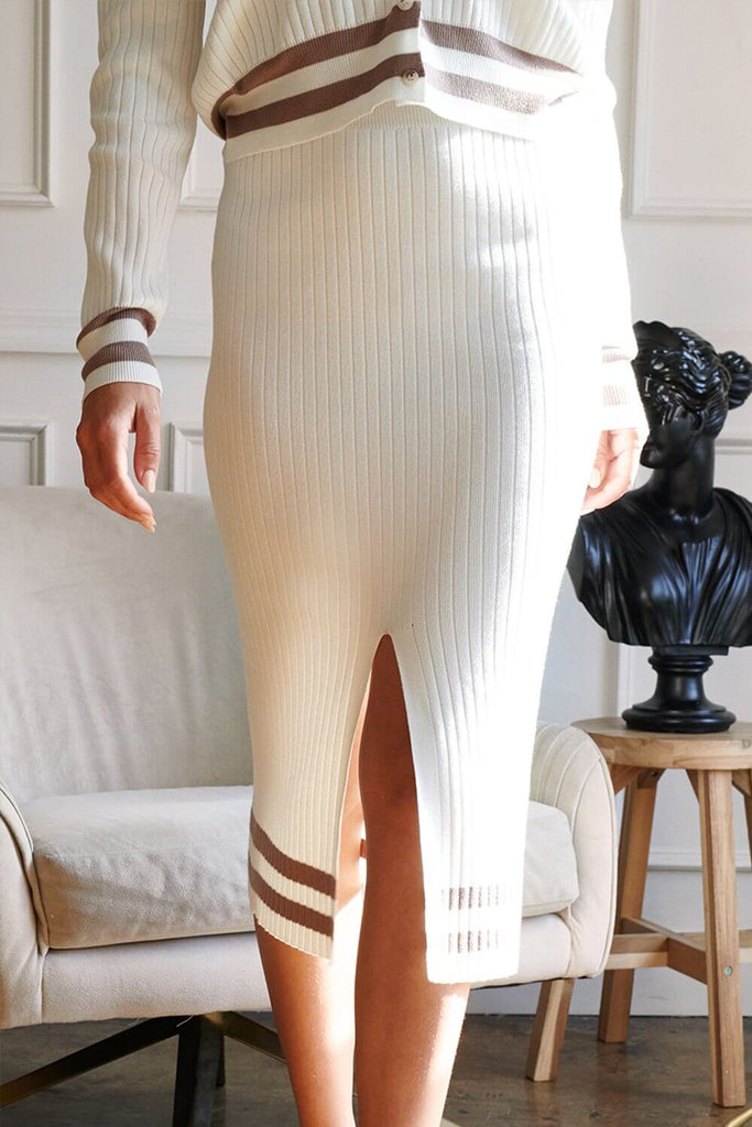 Close up of an ivory striped hem knit cardigan skirt set.