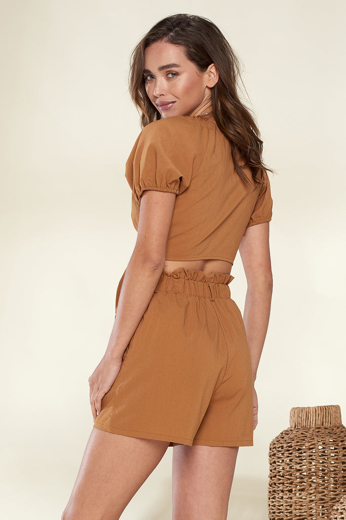 Back side of a brown tie front blouse set.