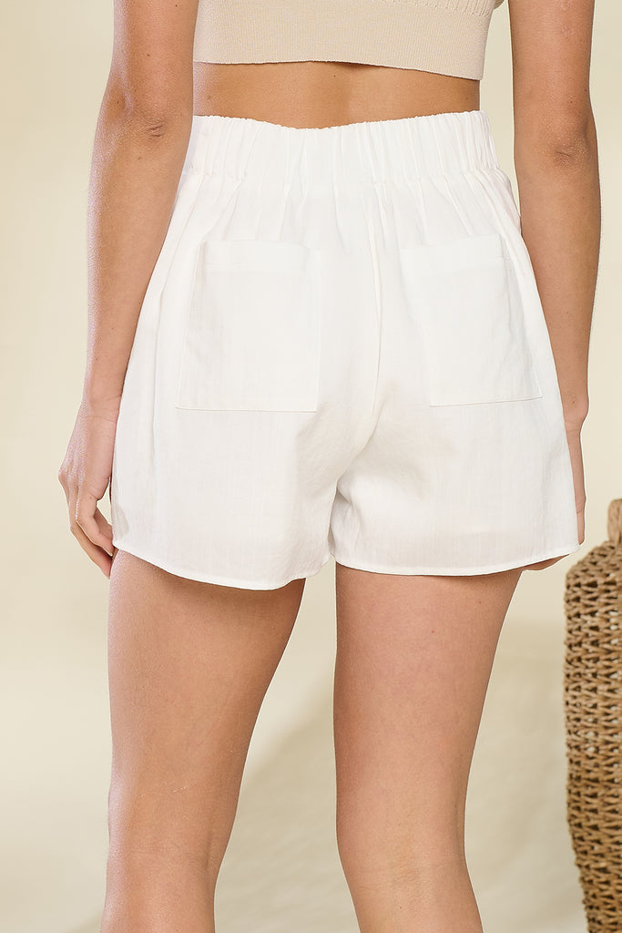 Back close up of an ivory shorts.