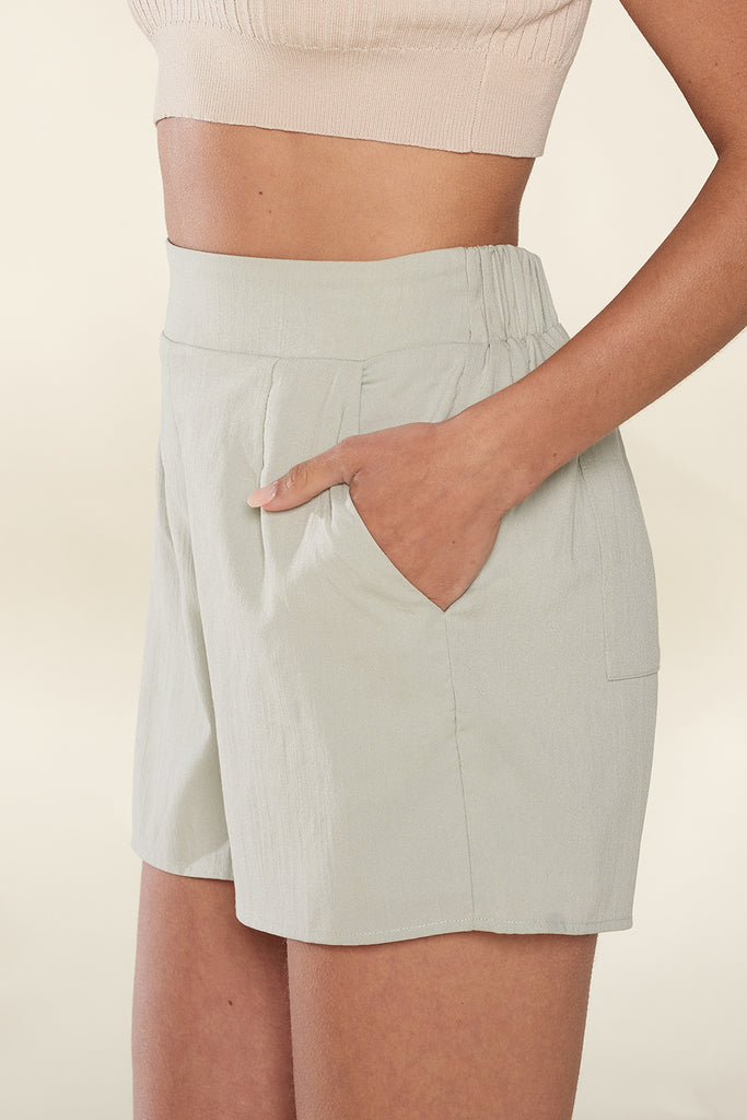 Side view of a sage shorts.