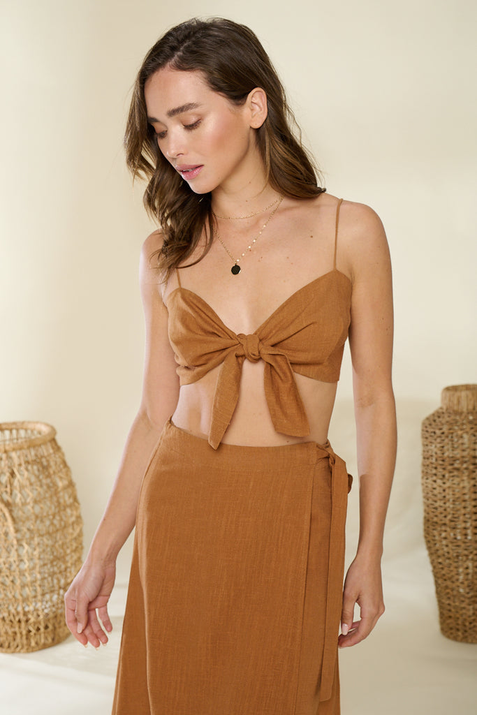 A close up of brown linen front tie top and skirt two piece set.