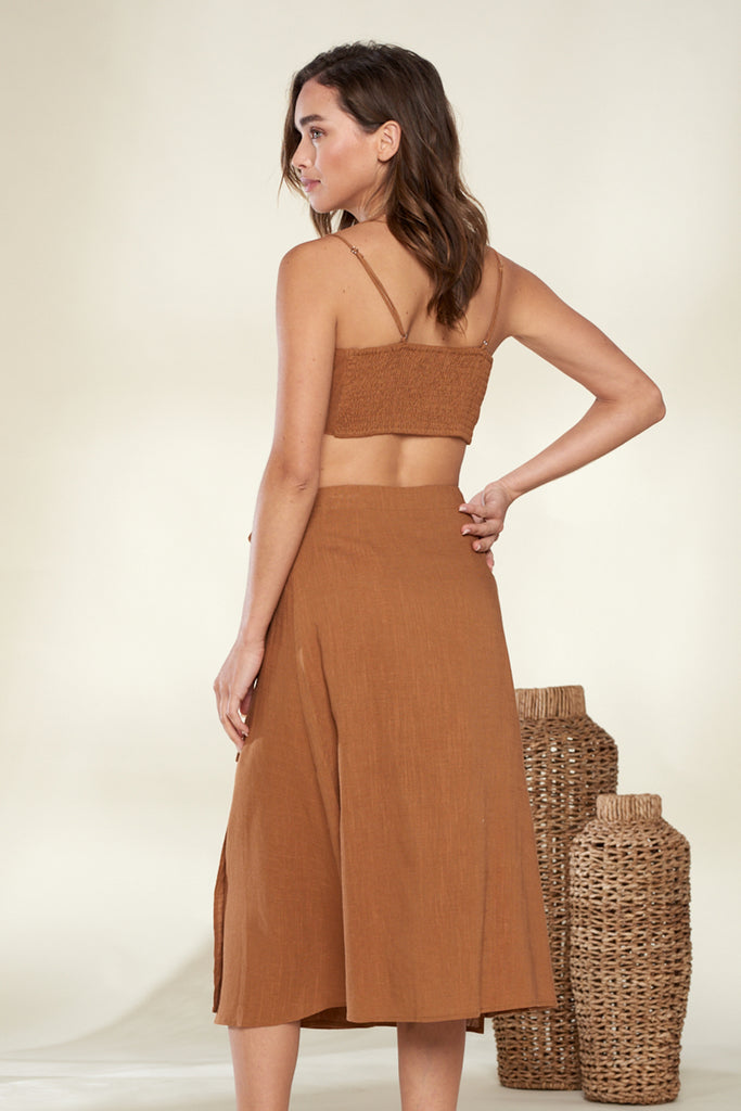 Back side of a brown linen front tie top and skirt two piece set.