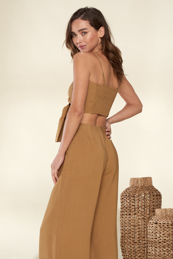 Back side of a khaki front o-ring buckle trim bandeau and wide leg pants two piece set.