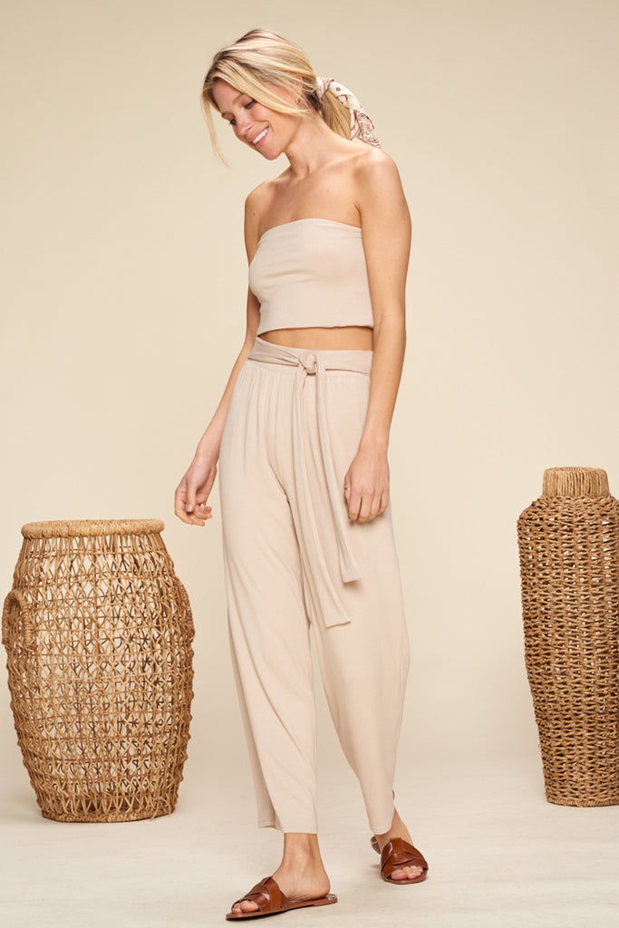 A woman wearing a sand ribbed knit two piece set.
