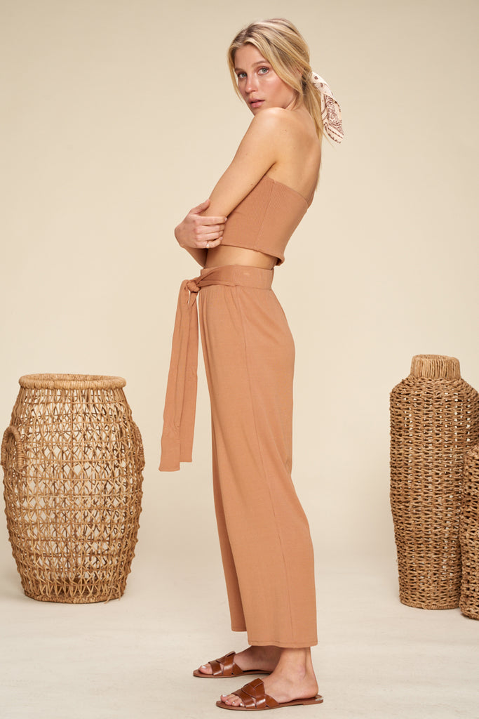 A woman wearing a brown ribbed knit two piece set.