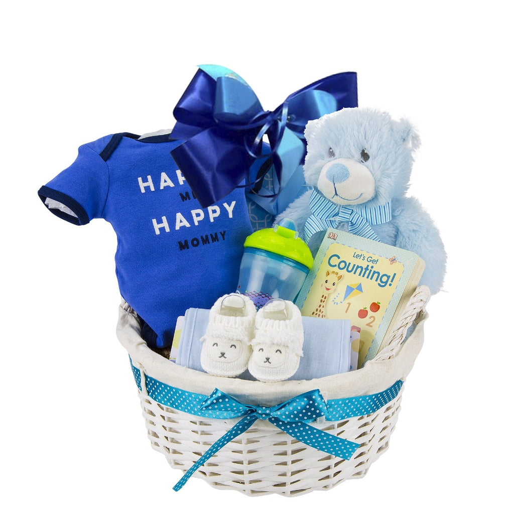 Gift basket for a baby boy filled with a blue shirt and blue teddy bear