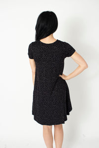 Black with white specks soft knit swing dress with pockets back view