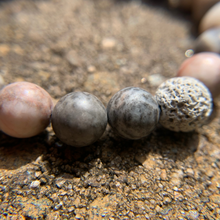 Load image into Gallery viewer, Pink Zebra Jasper essential oil diffuser bracelet with two lava rocks closeup