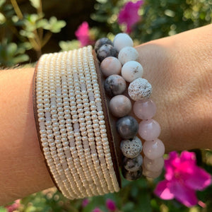 rose quartz and white magnesite beads essential oil diffuser bracelet with pink zebra jasper bracelet and African hand beaded leather cuff