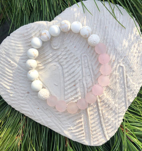 rose quartz and white magnesite beads essential oil diffuser bracelet with two lava rocks